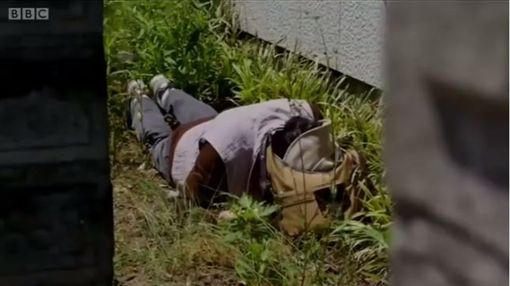 擔心北韓導彈來襲,日本民眾進行多次空襲演練。(圖/翻攝自BBC中文網)