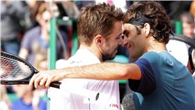 Monte Carlo Masters champion Stanislas Wawrinka, left, and Roger Federer hug after Sunday's all-Swiss final. (photo credit: Twitter)