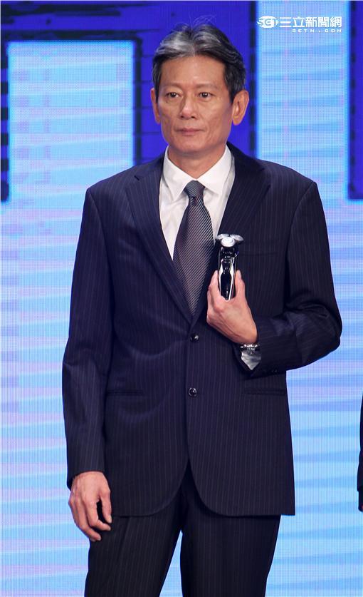 職棒總教練郭泰源攜手名模王心恬走秀。(記者邱榮吉/攝影)