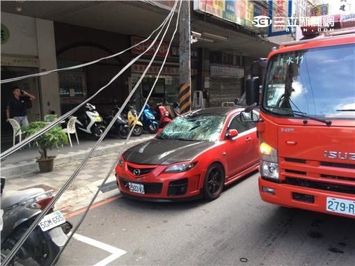 土城一名女子從11樓墜下摔至轎車車頂(翻攝畫面)