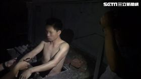 警方發現蘇姓逃逸外勞躲藏在空水塔中,隨即將他上銬逮捕。(圖/翻攝畫面)