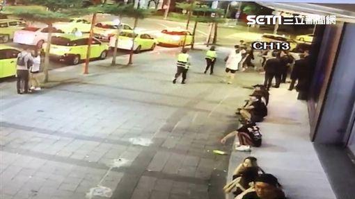 王姓男廚師酒後在夜店門口對6名陸生嗆聲,結果爆發激烈肢體衝突,李姓女警出面制止還受傷,支援警力抵達逮捕所有人,訊後依傷害及妨害公務等罪送辦(翻攝畫面)