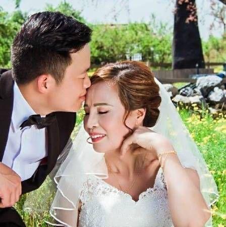 越南「嬤孫戀」趙後港、李杜秀婚紗照(圖/翻攝自《中國報》)
