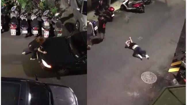 她深夜「起乩作法」 猛拍車頭躺地滾