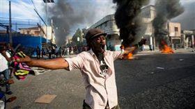 海地反總統抗議活動爆插曲 監獄78囚全逃脫(圖/翻攝自紐約時報)