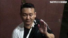 統促黨成員胡志偉被20萬元交保,強調自己原本只是要接近港獨人士,不知道被潑到紅漆的是何韻詩。(圖/記者楊佩琪攝)