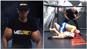 俄羅斯男子擁有24吋手臂,俄羅斯「卜派」慘被打趴在地。(圖/翻攝自Youtube)