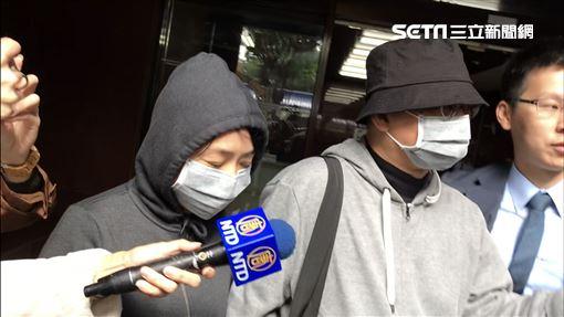 向心夫妻首度在鏡頭前正面現身,二度被傳喚離開台北地檢署。(圖/記者楊佩琪攝)