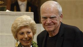 FILE - In this June 10, 2009, file photo, Czech-born author living in France Milan Kundera, right, is awarded the Simone and Cino Del Duca Foundation World Prize for his lifetime achievement in Paris,