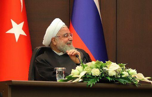 日本,伊朗,羅哈尼,訪問日本,安倍晉三,進行最終協調(圖/中央社)