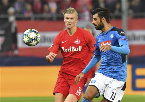 Salzburg's Erling Braut Haaland, left, duels for the ball against Napoli's Sebastiano Luperto during the Champions League Group E soccer match between FC Red Bull Salzburg and Napoli in Salzburg, Aust