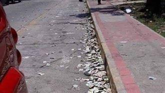 網傳義民眾扔紙鈔在街上 竟是假消息